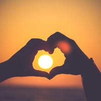 heart hands over sunset