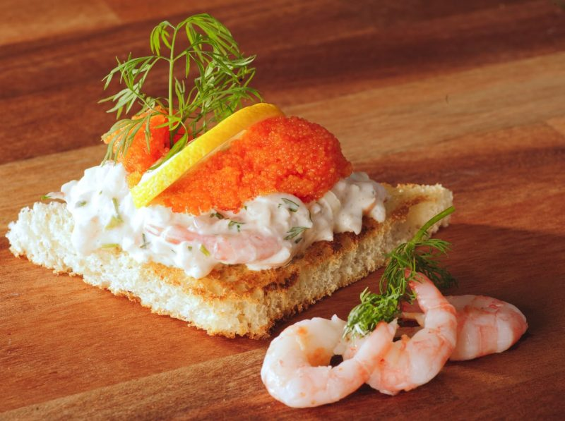 Toast Skagen - a traditional swedish food made with prawns, roe, and sauteed bread