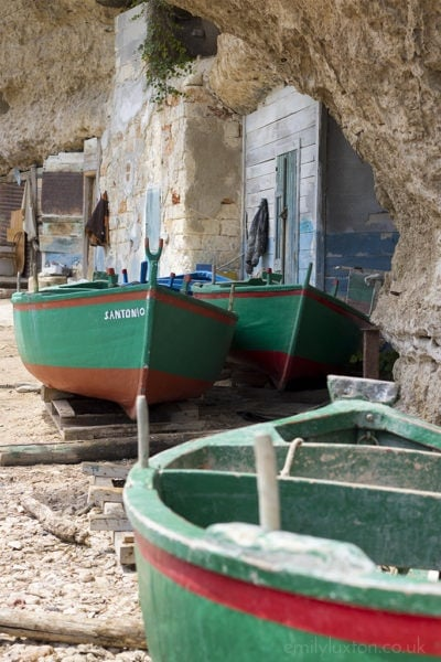 Wooden fishing boats on the coast in Puglia
