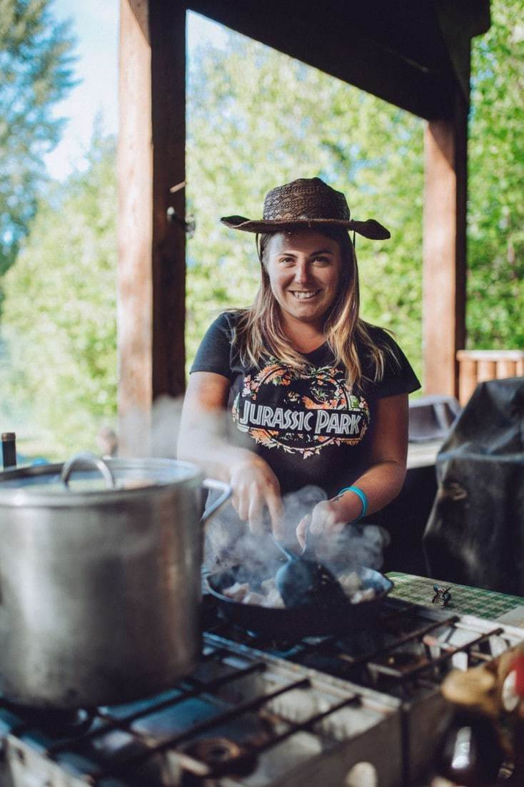solo traveller cooking at campsite on Trek America