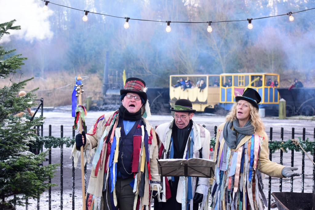 christmas carollers at traditional festival