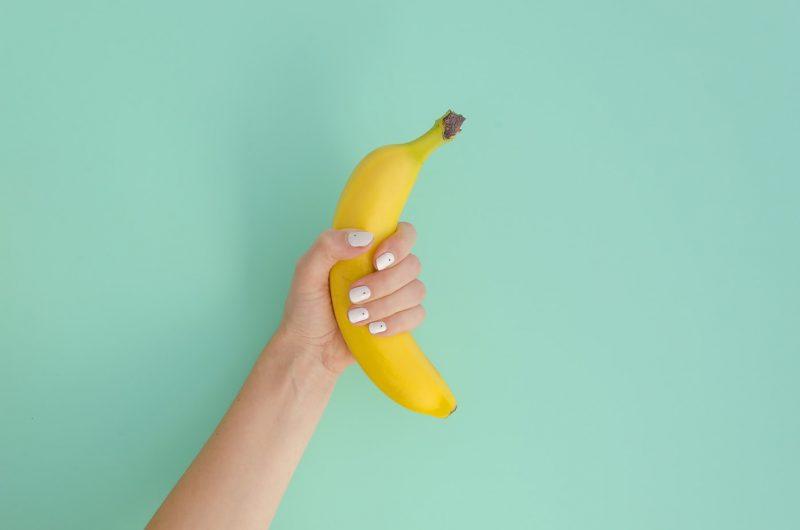hand holding a banana