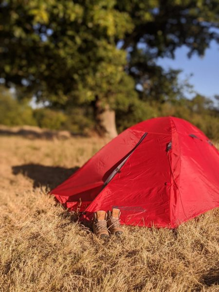 Hiking boots and tent