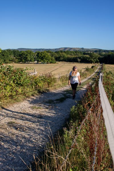 Travel Blogger Emily Luxton walking at Clarefield Copse Campsite