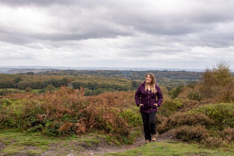 Girl wearing purple parka jacket hiking in the South Downs