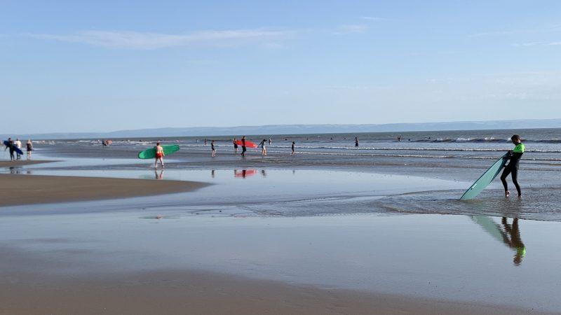 Surfers on Porthcawl Beach