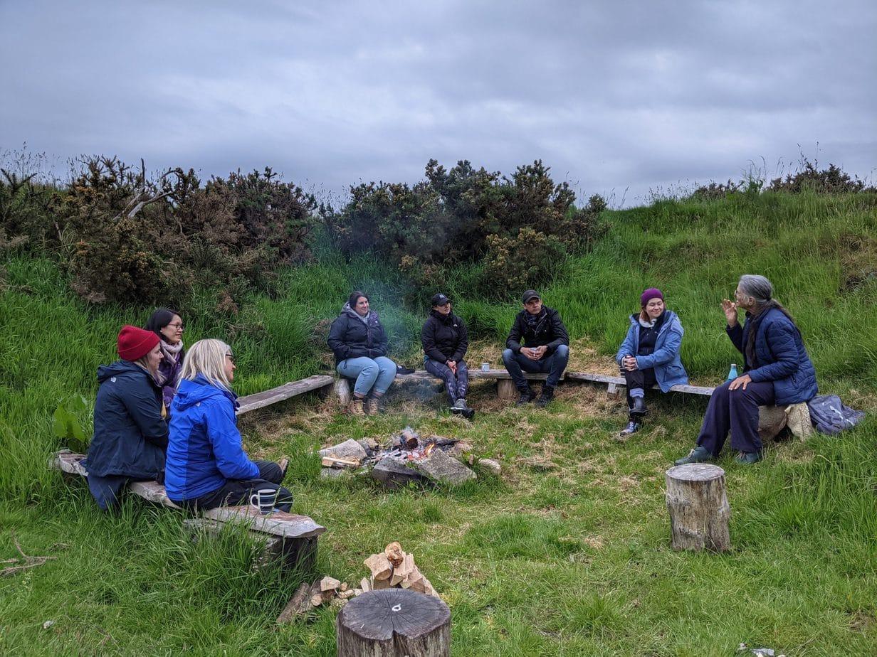 Storytelling around the campfire wild wellness retreat uk