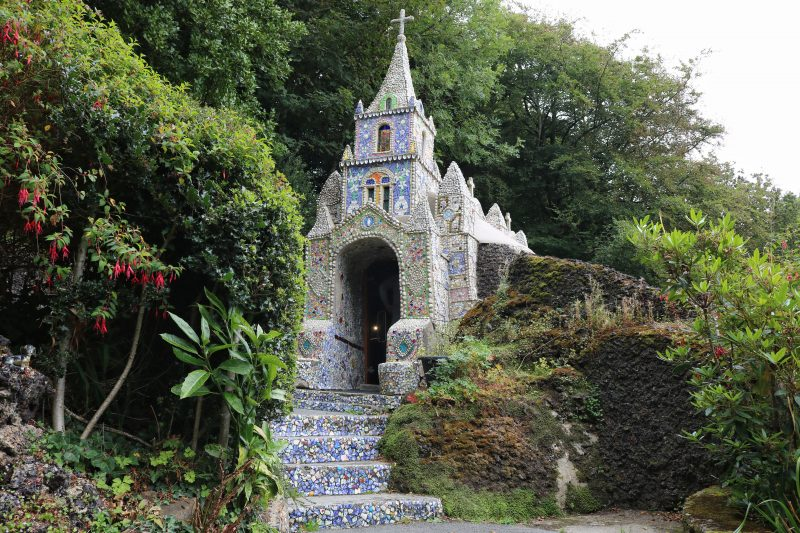 Small church covered in mosaic pieces